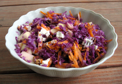 Breakfast.  Purple cabbage mixed with carrot, apple, pecans and goat cheese.